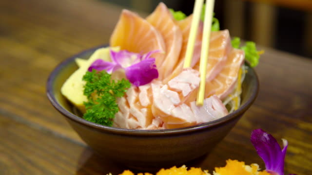 Closeup Salmon Sashimi Sushi in the Pot with Smoke.
