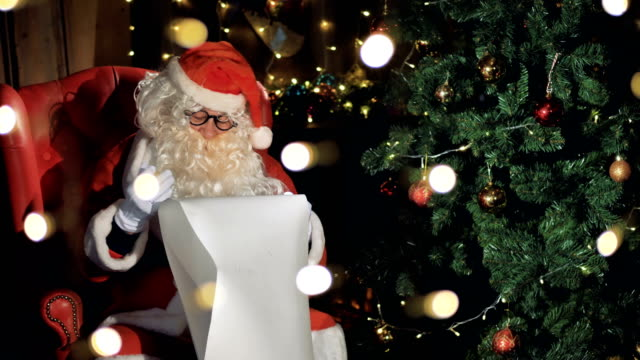 Closeup Santa Claus Reading Letters Near Christmas Fireplace 4k Stock Video Download Video Clip Now Istock