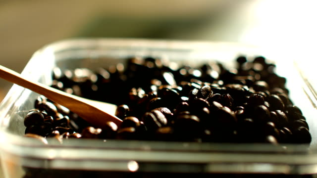 vídeos de stock e filmes b-roll de close-up shot : checking quality of roasted coffee beans - coffee table