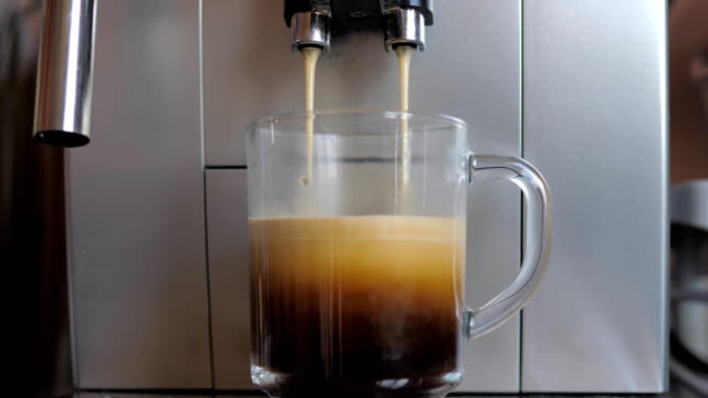 Closeup Shot From The Espresso Machine Or Coffee Maker Pours Coffee In Glass Cup video