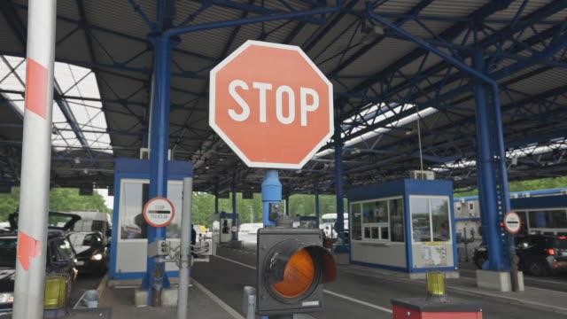 close-up shot of a barrier of stop sign at the border crossing stock video - chiuso video stock e b–roll