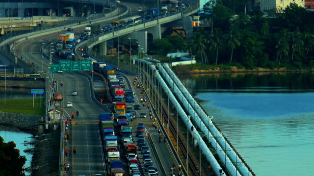 Closeup shot of a busy traffic at the Singapore causeway bridge A closeup shot of a busy traffic at the Singapore causeway bridge johor bahru stock videos & royalty-free footage