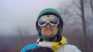 istock Closeup shot of a young man wearing a snow googles looks at a hillside. Winter holidays concept. Slowmotion shot 1203687910