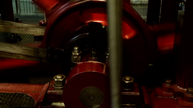 Closeup shot of an old industrial steam engine in motion Closeup shot of an old industrial steam engine in motion 19th century style stock videos & royalty-free footage