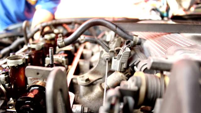 Closeup shot of auto mechanic working on a car video