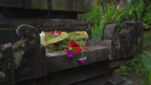 Closeup shot of Balinese offerings to the gods in the local temple. Balinese traditions. Balinese Hinduism