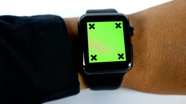 Close-up shot of Businessman using smart watch with green screen on white background, chroma key, dolly shot video