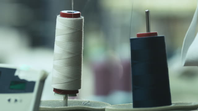Close-up shot of cotton threads for sewing machine in action. video