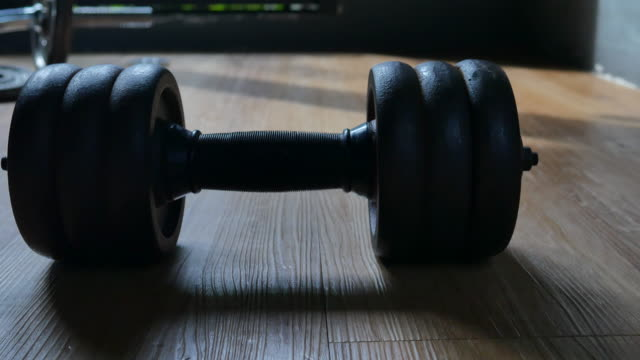 Closeup shot of dumbbells in the gym video