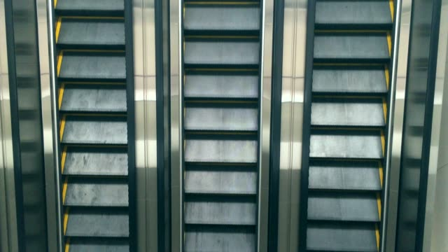 Close-up shot of empty moving staircase running up and down. Modern escalator stairs, which moves indoor. video