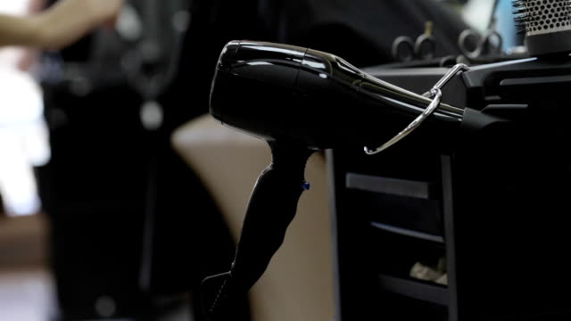 Close-up shot of hairdresser takes a hairdryer video