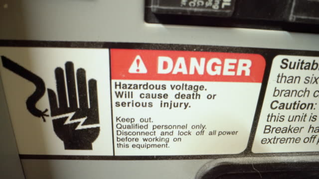 Close-Up Shot of High Voltage Danger Warning Sign Sticker on a 20-Amp Electrical Breaker Panel from a Commercial Building Install Close-Up Shot of Warning Sign Sticker on a 20-Amp Electrical Breaker Panel from a Commercial Building Install futebol stock videos & royalty-free footage