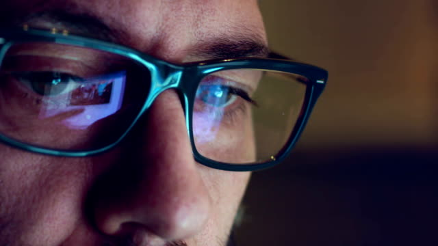 Close-up shot of man wearing glasses browsing the internet Creative Mature Adult Man Chatting Browsing at late night  - Close Up shot with Display Glasses Reflection financial occupation stock videos & royalty-free footage
