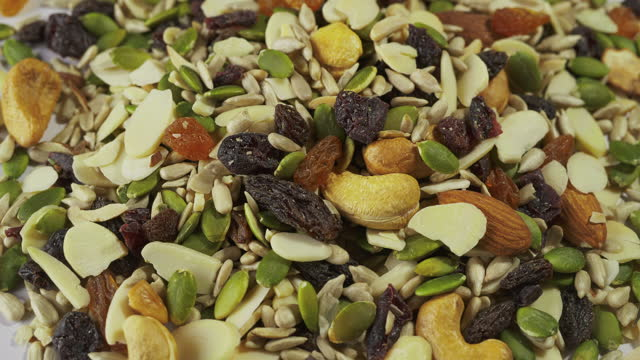 Closeup shot of mix whole grains turning on a white background