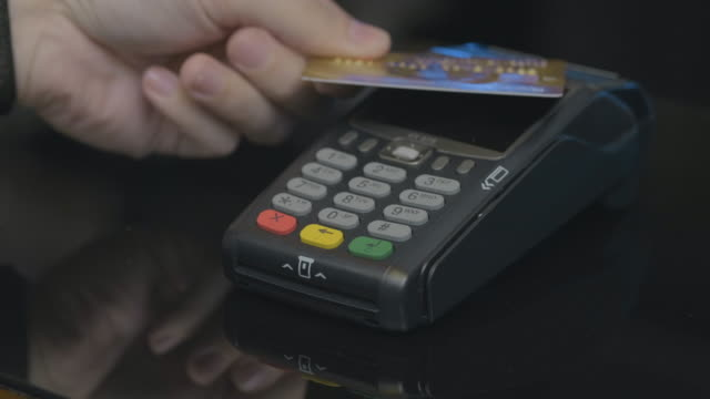 Close-up shot of person using mobile payment PayPass.