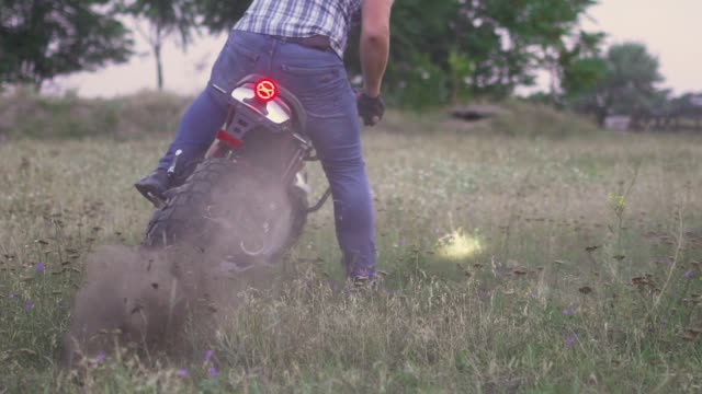 close-up shot of professional motorcyclist drift and turns on a motorcycle on the ground, a biker does a trick on a motorcycle. slow motion - freestyle motocross video stock e b–roll