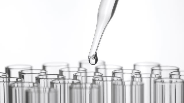 Closeup shot of scientist dripping liquid into test tube Closeup shot of scientist dripping liquid into test tube beaker stock videos & royalty-free footage
