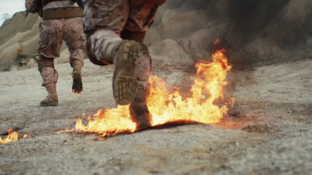 Close-up Shot of Soldiers Running on Burning Ground in the Desert. Slow Motion. - vídeo