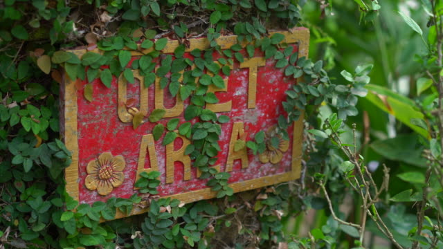 Closeup shot of the Quet area sign in a tropical spa