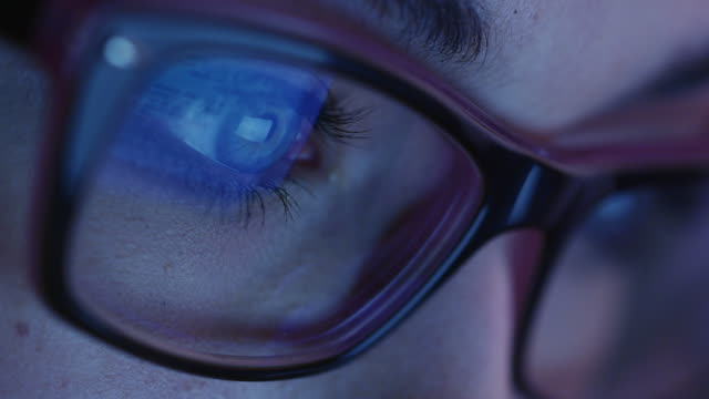 Close-up shot of woman eye in glasses staring at a working tablet screen in the dark. Close-up shot of woman eye in glasses staring at a working tablet screen in the dark. Shot on RED Cinema Camera in 4K (UHD). close to stock videos & royalty-free footage
