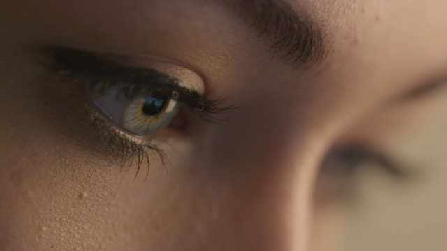 Close-up shot of woman eye with light day make-up. video