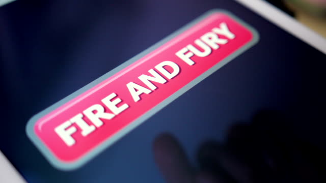 Closeup Shot Pressing Fire and Fury Button on Touchscreen Tablet PC video