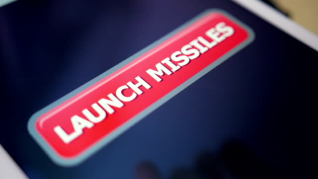 Closeup Shot Pressing Launch Missiles Button on Touchscreen Tablet PC video