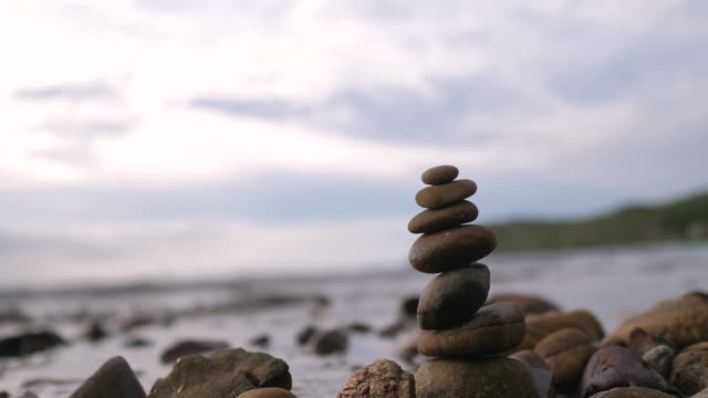 Close-up shot the rock stacked on the beach for health and nature therapy concept
