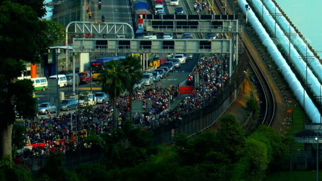 Closeup shot time lapse of a busy traffic at the Singapore causeway bridge Closeup shot of a busy traffic in time lapse at the Singapore causeway bridge johor bahru stock videos & royalty-free footage