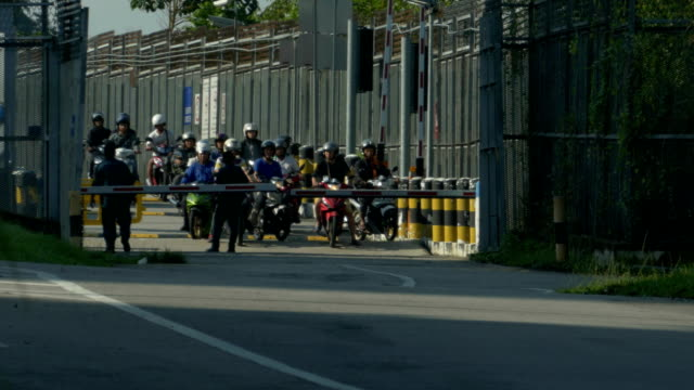 Closeup shot time lapse of a sea of motor bikes rushing out the Singapore Woodlands Checkpoint Closeup shot of a sea of motor bikes in time lapse rushing out the Singapore Woodlands Checkpoint johor bahru stock videos & royalty-free footage