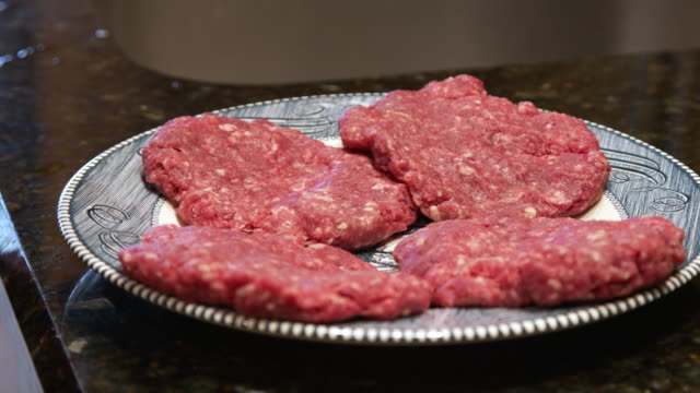 Close-Up Shots of Fresh Ready-to-Cook Pink Local Ground Beef Hamburger Patties Delicious Uncooked Raw Fresh Local American Food Ground Beef Hamburger Patties ground beef stock videos & royalty-free footage