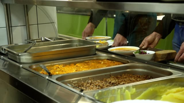 close-up, showcase with dishes in modern Self service canteen close-up, showcase with dishes in modern Self service canteen, cafeteria, mess hall, factory employees having lunch in the canteen, they are Served Meal In factory Canteen. cafeteria stock videos & royalty-free footage