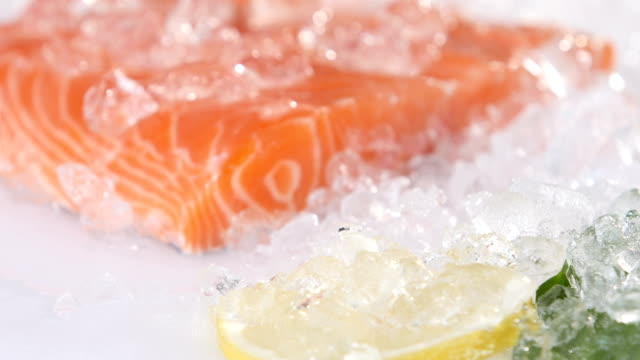 Closeup slice of red fish on ice in the market video
