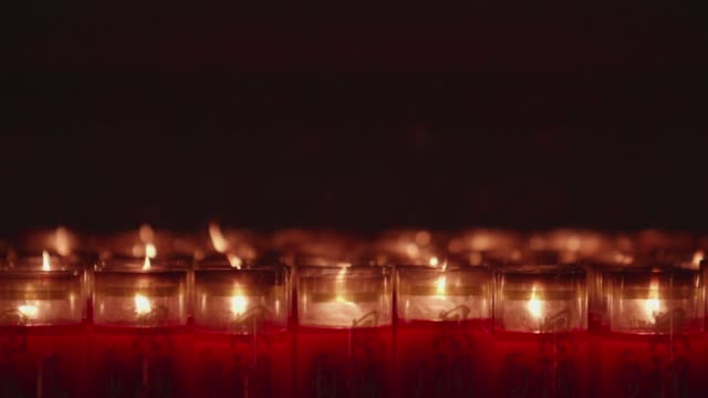 A closeup slow motion shot of flame on candle A closeup slow motion shot of flame on candle in asian temple buddhism stock videos & royalty-free footage