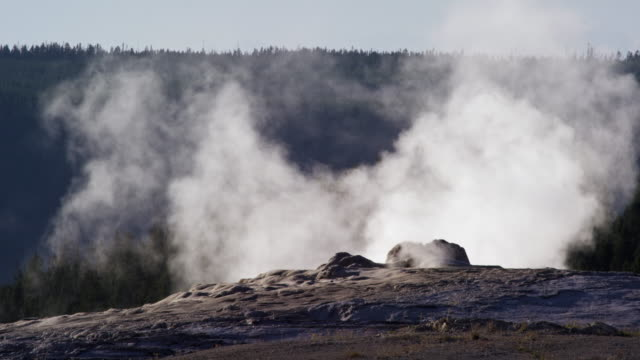 Close-Up Slow Motion Shot of Old Faithful Geyser Steaming in Yellowstone National Park in Wyoming
