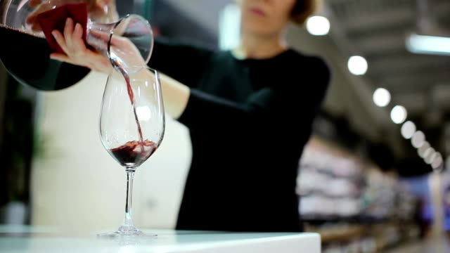 Close-up - sommelier pouring the wine in the glass video