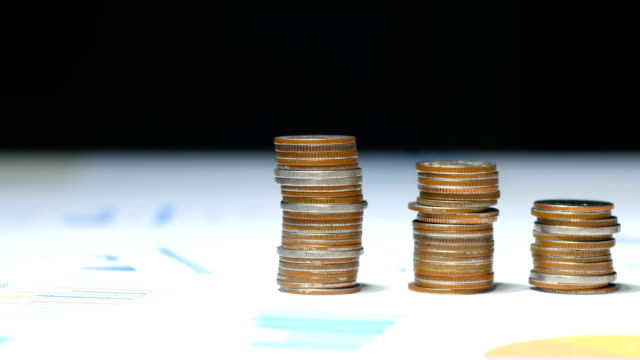 Close-up Stack of Coins on Financial Documents, Financial and Business Concept Close-up Stack of Coins on Financial Documents, Financial and Business Concept inflation stock videos & royalty-free footage