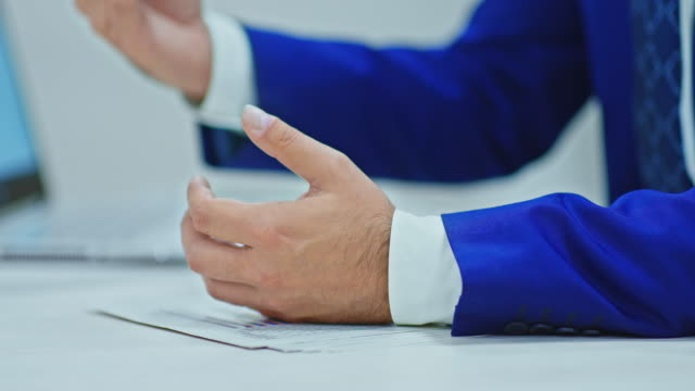 Close-up, the hand of a male businessman holds a pen and gestures, meeting. Hands of a businessman lie on documents, signing documents. 4k, ProRes