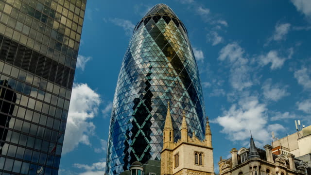 Close-up timelapse view of The Gherkin, London A close-up timelapse view of The Gherkin (30 St Mary Axe), one of the most famous landmarks of London, UK pickle stock videos & royalty-free footage