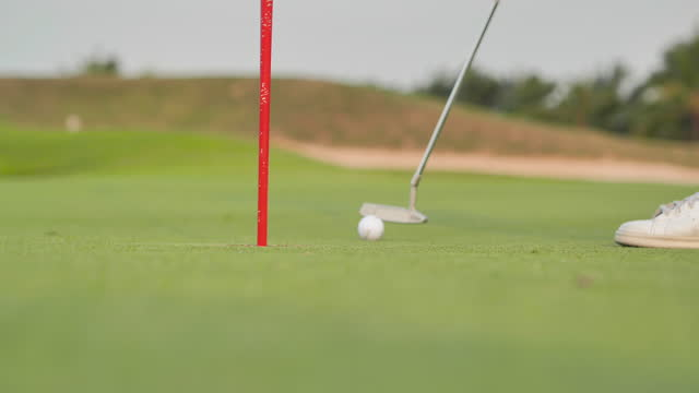 Close-up to golfers hit sweeping and keep golf course in the summer for relax time,Green golf field, Golfing Holidays.Sports Cinemagraphs.Golf Concepts