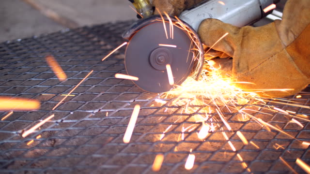 Close-up Using Machine Cutting Net Metal with Sparking
