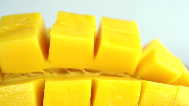 Close-up video dolly shooting,The mango cut in half saw the meat inside it fresh and appetizing. Close-up video dolly shooting,The mango cut in half saw the meat inside it fresh and appetizing. mango stock videos & royalty-free footage