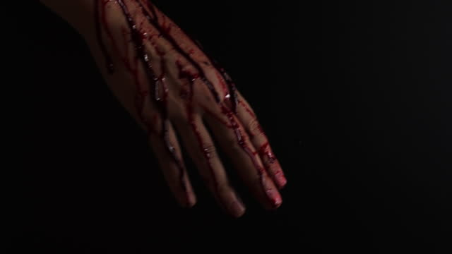 Close-up video of bloody hand