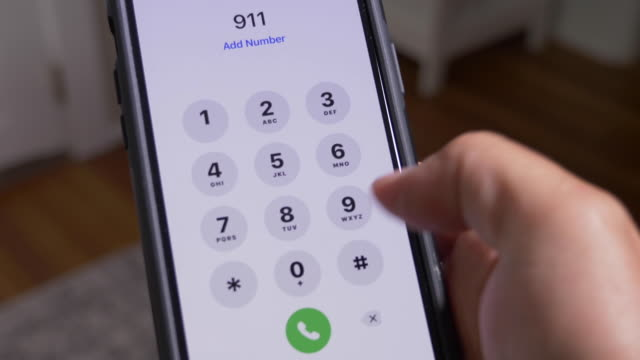 Closeup View Dialing 911 A closeup view of someone dialing 9-1-1 on their cell phone. 911 emergency services in America became a hot topic during the Defund the Police movement of 2020. dial stock videos & royalty-free footage