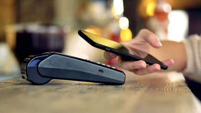 Close-up view of a NFC transaction with a smartphone.