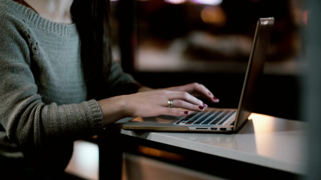 close-up view of female hands typing on laptop computer keyboard. young woman sitting on the table and working - online banking video stock e b–roll