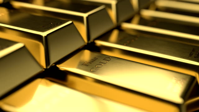 Close-up view of fine gold bars with interesting play of light and shadow Close-up view of fine gold bars stack. Camera moving over stairs of stacked fine gold bars. Fine detalization and play of light and shadow allow us to see every scratch on golden bars surface. gold bars stock videos & royalty-free footage