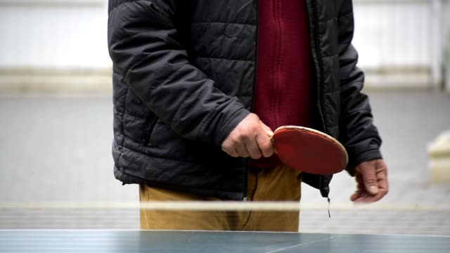 Close-up view of mature man playing table tennis