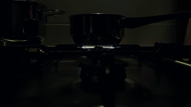 Close-up view of the blue flames of a home kitchen stove