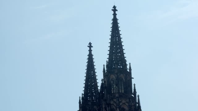 close-up view of top of saint vitus cathedral in prague castle against clear blue sky - gothic fashion stock videos and b-roll footage